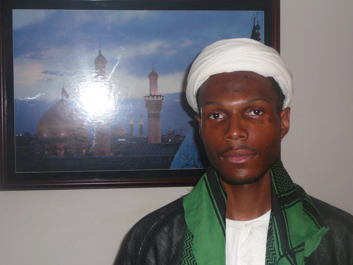 Malcolm, dressed here as a traditional Muslim scholar, wanted to go to Qom, Iran, and study to be a scholar.