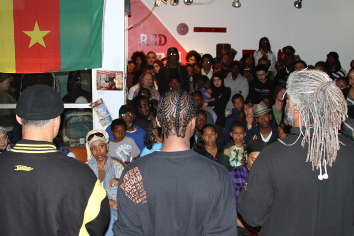 Malcolm Shabazz speaks to a packed house at the Black Dot Cafe in West Oakland in 2010 – his very first speaking event in the Bay. – Photo: Block Report