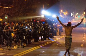Michael-Brown-rebellion-protester-hands-up-defies-militarized-cops-Ferguson-081914-by-Xinhua-News-Agency-300x196, Join the #HandsUp mass mobilization in Ferguson Oct. 9-13, National News & Views
