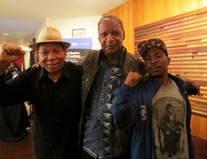 """Black Panther veteran and, after 44 years, recently released political prisoner Marshall Eddie Conway stands between fellow freedom fighters Melvin Dickson and JR Valrey at the Berkeley Rep, where they attended the Bay Area premiere of """"Party People."""" – Photo: Carole Hyams-Howard"""