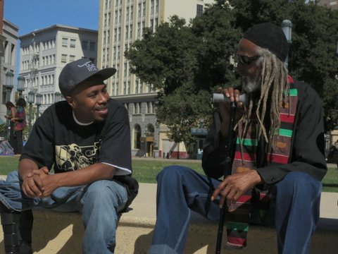 Black-Panther-Party-46th-Anniversary-JR-with-boot-Elder-Freeman-at-Oscar-Grant-Plaza-101312-by-Carole-Hyams, Salute to the Freeman Brothers! Last testament of Elder Freeman, a giant of a man, Culture Currents