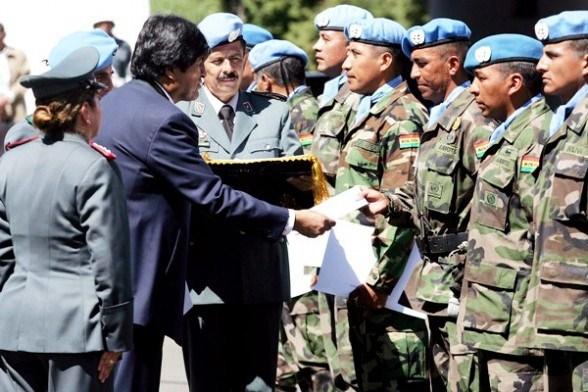 Bolivian President Evo Morales reviews U.N. troops in Haiti.