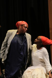 """Contrena Jones (left) as the wife of John Ross Jr. is comforted by plantation worker Kehinde Kujichagulia-Seitu in """"Go Tell It!"""""""