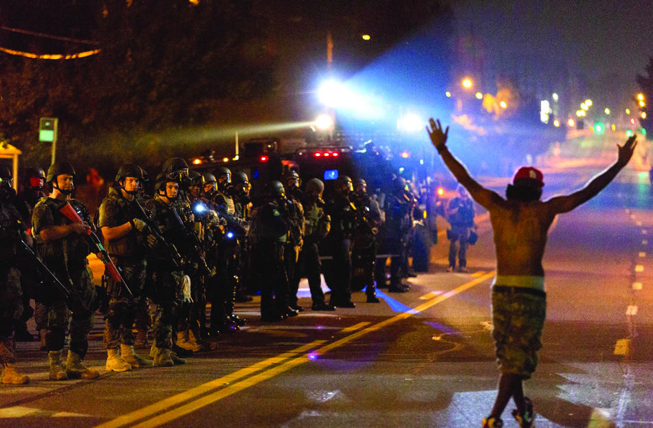 Fearless Ferguson youth, pictured night after night defying militarized cops, inspired the world. – Photo: Xinhua News Agency