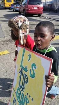 """The """"L's Up, Guns Down!"""" peaceful march and rally was held on Dec. 6 in Deep East Oakland, calling for a peace truce. Even the youngest children have lost loved ones. – Photo: PNN"""