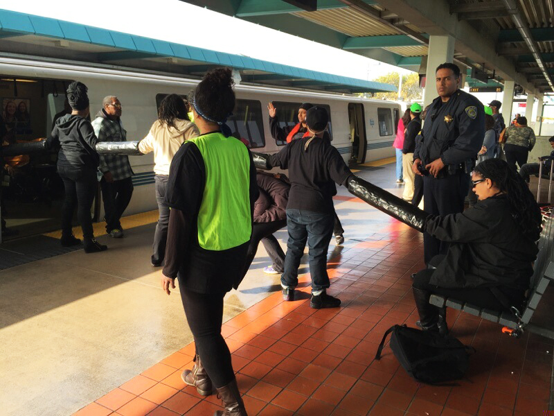 A small group of activists managed to disrupt the Black Friday shopping craze in the Bay Area.