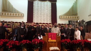 Michael Brown Sr. stands beside Rev. Dr. Amos C. Brown in the pulpit at Third Baptist Church. – Photo: Kia Croom