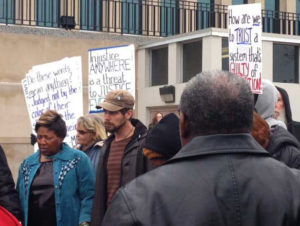 Supporters of Rev. Pinkney gather outside the courthouse after his sentencing. He is strongly supported in Benton Harbor, loved for his courage in defending the town from extinction at the hands of officials who take orders from Whirlpool and other corporate bosses rather than the people. – Photo: ABC News