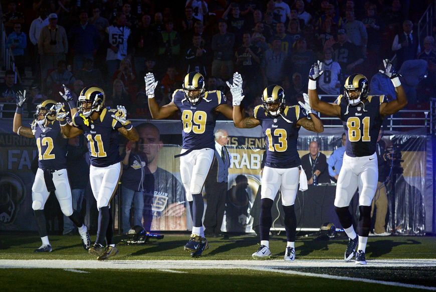 """St. Louis Rams players Stedman Bailey, Tavon Austin, Jared Cook, Chris Givens and Kenny Britt took the field signaling """"Hands up, don't shoot"""" to protest the police murder of Michael Brown at the start of the Oakland Raiders game on Sunday, Nov. 30. – Photo: Jeff Curry, USA Today Sports"""