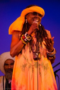 Kujichagulia performs again at the second Black Media Appreciation Night, on Sept. 13, 2014. Behind her is Val Serrant, who makes drums talk. – Photo: William H. Jones Jr.