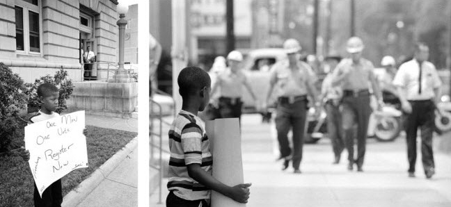 """A brave young boy, whose sign reads, """"One man one vote,"""" demonstrates for freedom in front of the Dallas County courthouse in Selma on July 8, 1964. Selma sheriff deputies approach and arrest him. – Photos used by permission of Matt Herron, Take Stock Photos"""