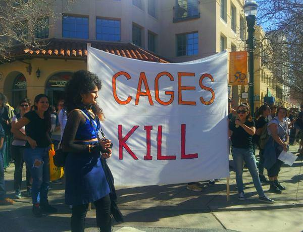 """Sin Barras organized the Cages Kill-Freedom Rally to save lives after six people locked up in the Santa Cruz County Jail have died since August 2012, declaring, """"These deaths are an act of collective punishment against people who are most in need of aid, and who are consistently denied community-based resources."""" – Photo: Denica De Foy"""