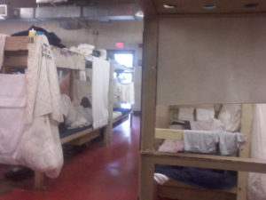 After a roof caved in a year ago in another part of the prison, more beds were moved into this already overcrowded dorm.