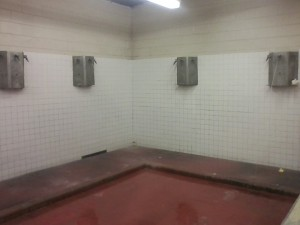 Finally, a wall has been built to enclose the showers.