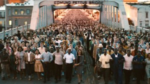 "In a scene from the new movie, ""Selma,"" marchers finally, with Dr. King in the lead, cross the Edmund Pettus Bridge out of Selma on their way to Montgomery, their numbers growing as they walked. On their first attempt to cross the bridge, John Lewis and others were nearly beaten to death."
