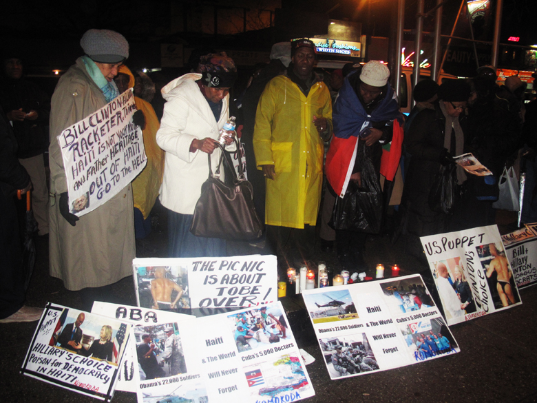 """In the freezing New York cold on Jan. 12, 2015, Haitians protest in front of Bill Clinton's Harlem office, saying """"No to dictatorship, down with the U.N., down with the U.S. puppet Martelly government!"""" – Photo: Dahoud Andre"""
