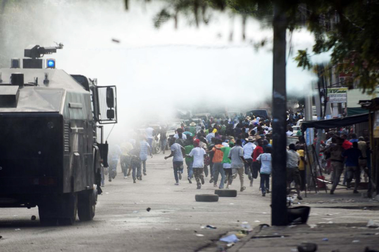 Haitian police are militarized now, doing what police do in Ferguson, Missouri. They were trained by U.S. and Canadian police to put down the protests against dictatorship, but the protests only grow.