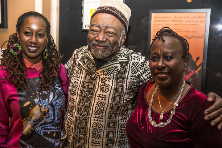 Askia Toure beams as he embraces Teju N. Adisa Farrar and Opal Palmer Adisa, daughter and mother. – Photo: Malaika Kambon