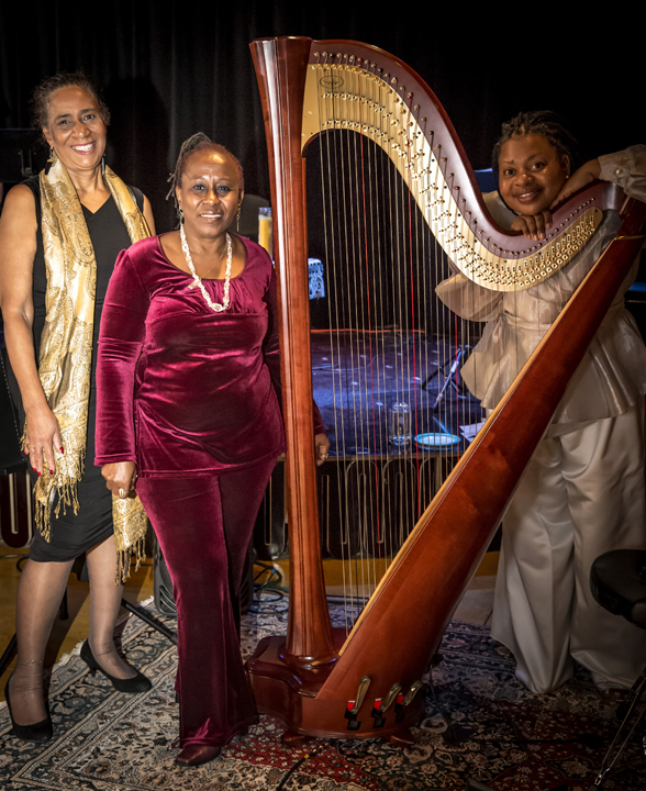 """""""Incantations and Rites"""" was presented Dec. 6 by Daughters of Yam (at left) – devorah major and Opal Palmer Adisa – featuring their poetry and the music of Destiny Muhammad, Harpist from the Hood. – Photo: Malaika Kambon"""