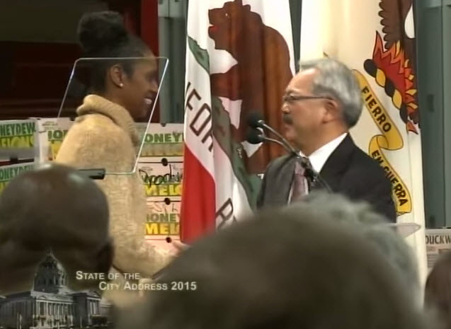 Following her introduction, Nicole Banks welcomes Mayor Ed Lee to the stage at the Wholesale Produce Market, one of countless new buildings in San Francisco.