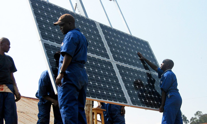 Rooftop solar installation is one of the best opportunities to return the unemployed to the workforce, a top priority in poor communities of color. These trainees are installing panels on a clinic in Rwanda. If Africans can do it, so can African Americans. – Photo: Walt Ratterman, Sunepi