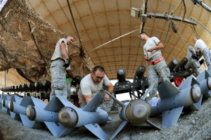 Master Sgt. Adam, middle, preps the KMU-572 fins for assembly onto the MK-82 munitions Dec. 21, 2014, in Southwest Asia. Adam is the NCO in charge of conventional maintenance and is deployed from Seymour Johnson Air Force Base, N.C. – Photo: Senior Master Sgt. Carrie Hinson, U.S. Air Force