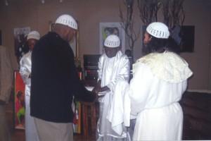 The washing of hands is a purification ritual at Yalani's Kinseyaba.