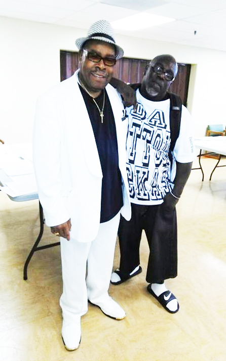 "Bishop Henry C. Williams and Robert ""Fleetwood"" Bowden take a break from filming ""Da Cotton Pickas."""