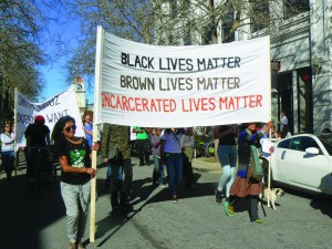 United against police and prison abuse, and imprisonment itself, formerly incarcerated people, the advocates of Sin Barras and activists from around the Bay came to Santa Cruz Jan. 24, 2015, for the Cages Kill-Freedom Rally. – Photo: Lori Nairne