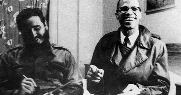 Fidel Castro and Malcolm X share a laugh as they meet in Harlem's Theresa Hotel on Sept. 24, 1960.