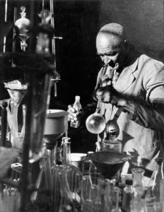"""George Washington Carver in His Lab,"" 1930, a gelatin silver photograph – Photo: P.H. Polk"