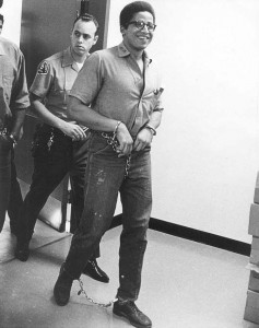 Best-selling author George Jackson always maintained his dignity, smiling even in chains.