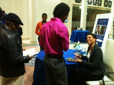 """After speaking in New Orleans, Michelle Alexander speaks with Dillard University student LeQuan Woods as she signs his copy of her book, """"The New Jim Crow: Mass Incarceration in the Age of Colorblindness."""" – Photo: Naomi Martin, Times-Picayune"""