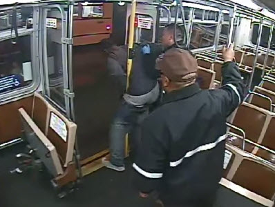 SFPD Officer Raymond Chu brutally shoves Bernard Warren off the bus. – Photo: Muni video screenshot