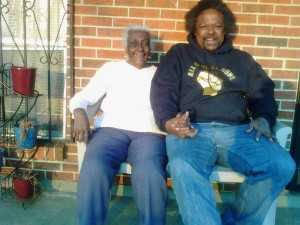 Arthur League joins a local Selma woman on her porch. All of Us or None members parked in front of her house and struck up a conversation with her. She is 90 years old and has lived in her house in Selma since she was a baby.