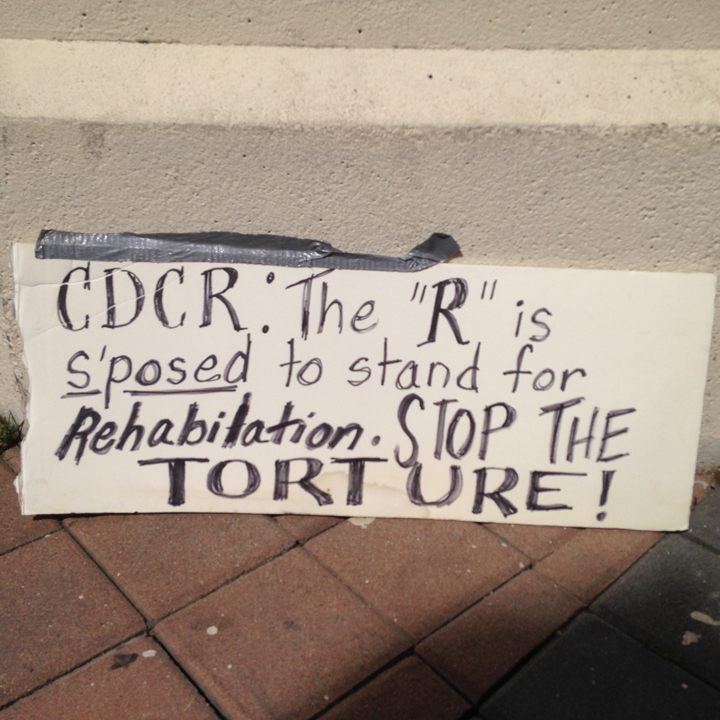 This imaginative sign appeared at the Oakland action on March 23.