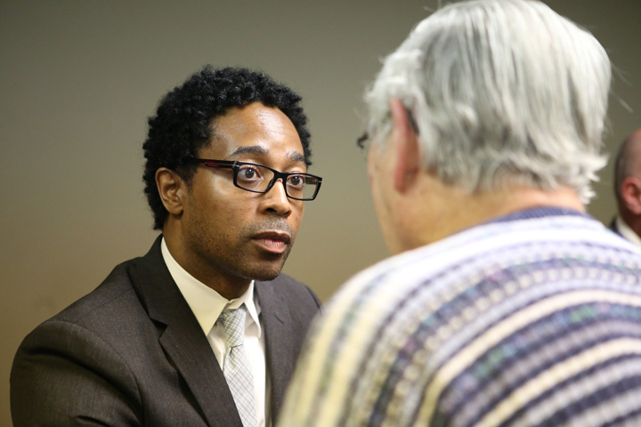 Attorney and Municipal Judge Wesley Bell, now running for Ferguson City Council, listens to a voter at a candidate forum March 12. – Photo: Ben Kesling