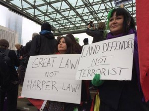 """Native Canadians protest C-51, the Canadian """"anti-terrorist"""" legislation that would criminalize anti-fracking and anti-tar sands activists, First Nations defenders and critics of Israel. """"Great Law"""" is the Great Law of Peace of the Six Iroquois Nations: Oneida, Mohawk, Cayuga, Onondaga, Seneca and Tuscarora."""