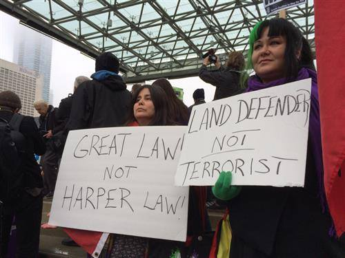 "Native Canadians protest C-51, the Canadian ""anti-terrorist"" legislation that would criminalize anti-fracking and anti-tar sands activists, First Nations defenders and critics of Israel. ""Great Law"" is the Great Law of Peace of the Six Iroquois Nations: Oneida, Mohawk, Cayuga, Onondaga, Seneca and Tuscarora."