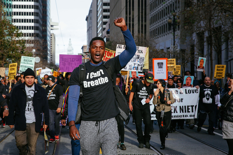 """Thousands march up San Francisco's Market Street in the youth-organized """"Millions March"""" against police brutality in cities around the country on Dec. 13, 2014. Since then, SFPD has taken four more lives. – Photo: Jeremy Raff, KQED"""