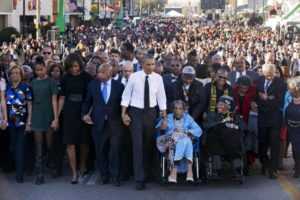 Obamas-lead-march-Barack-holding-hands-w-John-Lewis-Amelia-Boynton-Robinson-103-in-wheelchair-both-beaten-Bloody-Sunday-Selma-030715-by-Jacquelyn-Martin-AP-300x200, Mumia Abu Jamal: Unsaid at Selma, National News & Views