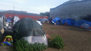 "Tent ""city"" in the ""Chinatown"" area of Salinas, where houseless, gentriFUKed Salinas families and folks try to live peacefully and are constantly harassed by police. The day after we came, one of the houseless organizers in Chinatown had his RV seized. – Photo: Poor News Network"