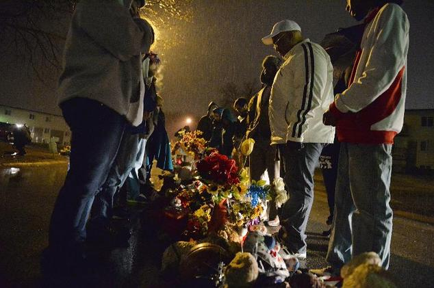 Protestors gather at the memorial for Michael Brown where he was murdered in the street outside the Canfield Apartments in Ferguson, Missouri, on March 13. – Photo: ©Michael B. Thomas, AFP