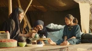 "Satima (Toulou Kiki), her husband, Kidane (Ibrahim Ahmed aka Pino), and child, Toya (Layla Walet Mohamed), in ""Timbuktu"""