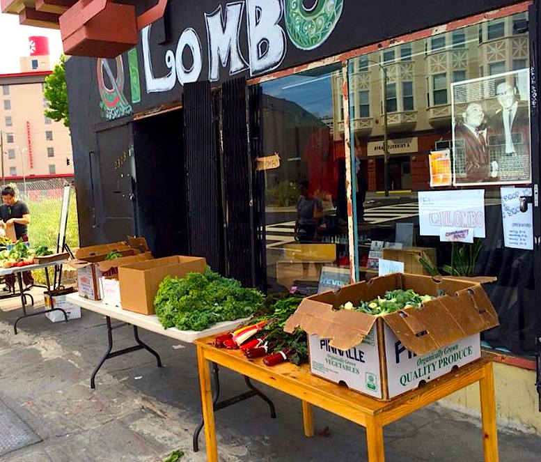 AfrikaTown produce is displayed outside Qilombo, available to the neighborhood.