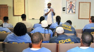 "Michael Spencer recommends that prisoners transitioning from SHU to mainline ""get connected to as many self-help programs as you can."" At San Quentin Prison, Curtis Carroll, 36, who's been in prison since he was 15, has gained a reputation for his self-taught stock-picking prowess, earning the nickname ""Wall Street."" He teaches financial literacy to fellow prisoners. – Photo: CDCR"
