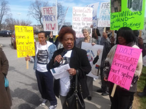 Dorothy Pinkney, Rev. Pinkney's wife and an outstanding activist in her own right, leads the rally following the court hearing on April 14. She is calling on everyone to boycott all stores that sell Whirlpool products and to refrain from buying any Whirlpool products until Rev. Pinkney is released from prison. – Photo: Abayomi Azikiwe