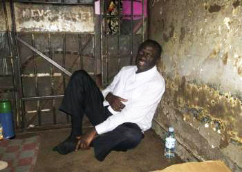 Dr. Kizza Besigye in jail after one of his many arrests by Uganda's military police
