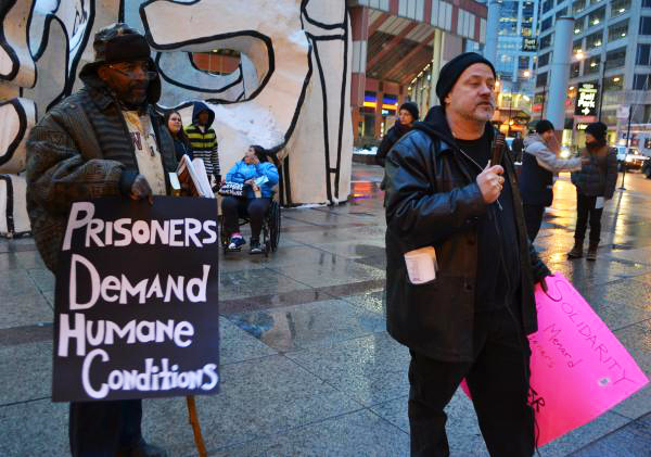 Supporters – many who were formerly incarcerated – rallied in the rain in Chicago on Feb. 13, 2014, during the long, strong hunger strike at Menard.