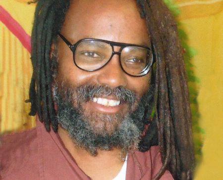 Mumia-Abu-Jamal-2013-web, Mumia's son says, 'My father is in pain,' as Mumia is sent back to prison, Behind Enemy Lines